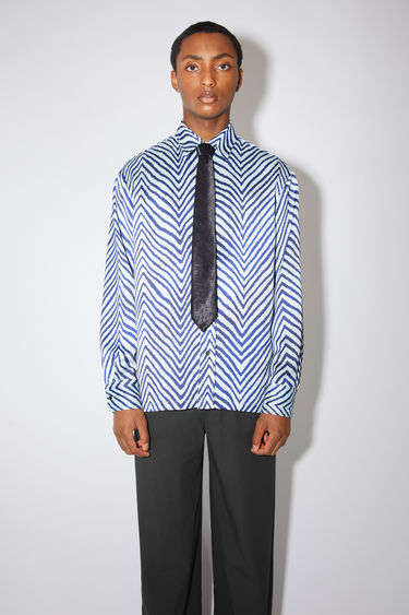Acne Studios blue/navy casual long sleeve shirt has a slightly oversized fit and features a graphic zebra print.