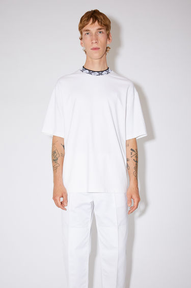 Acne Studios optic white relaxed fit t-shirt is made of technical jersey with a jacquard face logo ribbed neckline and face logo patch at the chest.