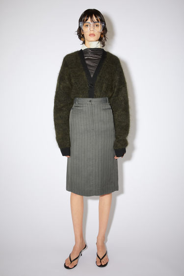 Acne Studios grey/black striped structured skirt is made of a linen blend with two front welt pockets.