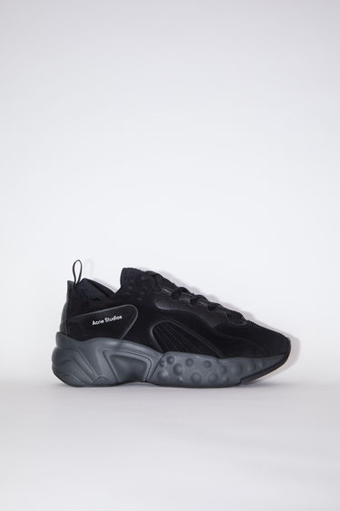 Acne Studios Manhattan multi black sneakers take cues from '90s American sportswear. They are crafted to a bulky silhouette from suede and set on a sculpted platform sole. The size runs larger, please take a size smaller than usual.