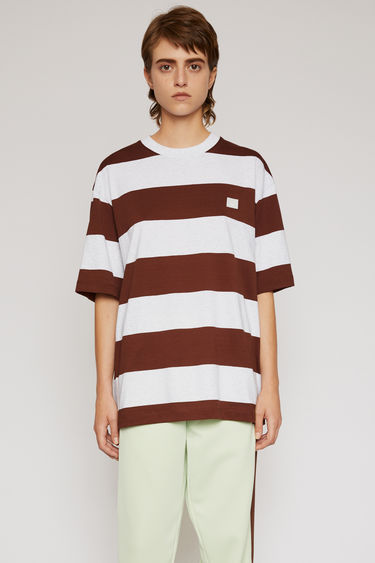 Acne Studios cognac brown t-shirt is cut to a loose silhouette in cotton jersey and patterned with block stripes.