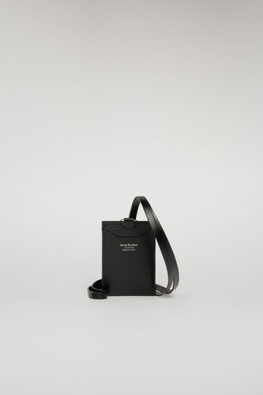 Acne Studios black lanyard doubles as a cardholder - it's crafted from smooth leather and features four card slots and a logo-engraved ring clasp.