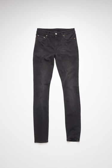 Acne Studios Climb Used Black jeans are crafted from super stretch denim that's washed for a soft, faded finish. They're sit at a mid rise with skinny legs that taper and crop at the ankles.