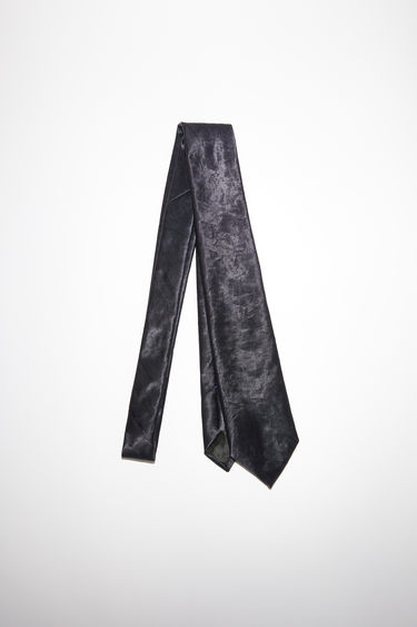 Acne Studios black classic fit tie is made of shiny, fluid nylon.