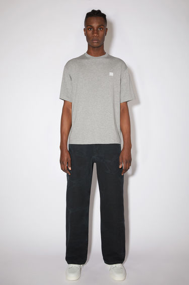 Acne Studios light grey melange relaxed fit t-shirt is made of organic cotton with a ribbed crew neck and face logo patch.