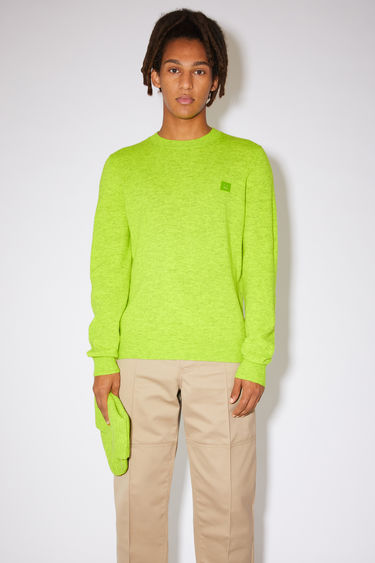 Acne Studios neon green crew neck sweater is made from wool with a face logo patch and ribbed details.