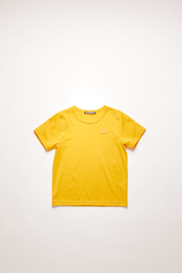 Acne Studios Mini Nash Face honey yellow t-shirt is cut from a lightweight cotton jersey with a ribbed crew neck and short sleeves, then accented with a tonal face-embroidered patch on front.