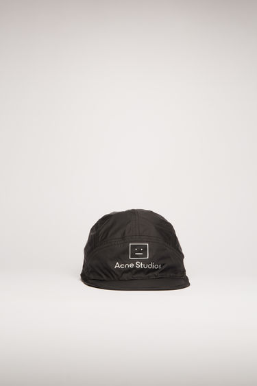 Acne Studios black nylon cap is crafted to a five-panel shape with a flat brim and accented with a reflective face-logo print on front.