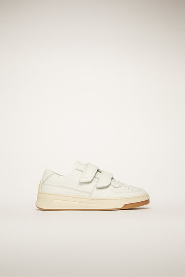 Acne Studios Mini Steffey white sneakers are crafted to a low-top silhouette with calf leather and fastened with velcro straps.