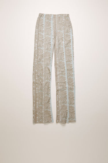 Acne Studios light blue trousers are crafted from woven jacquard spliced by lurex fibres and shaped with a high-rise elasticated waist and straight legs.