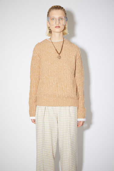 Acne Studios warm beige crew neck sweater is made of a textured ribbed knit with a straight, elongated fit.