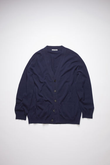 Acne Studios navy v-neck cardigan sweater is made of lambswool with rib knit details at the cuffs and hem.