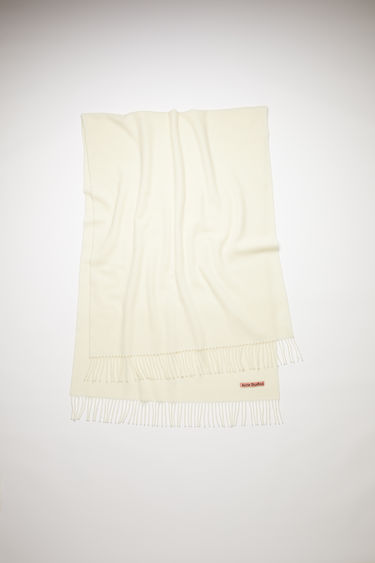 Acne Studios white oversized fringed scarf is made of pure wool, featuring a label in one corner.