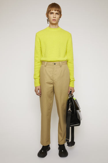 Acne Studios mushroom beige chinos are cut to a carrot-leg fit with single front pleats and finished with wide belt loops and back patch pockets.