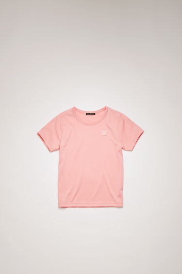 Acne Studios Mini Nash Face blush pink t-shirt is shaped with a crew neck and short sleeves and finished with a tonal face-embroidered patch on the chest.