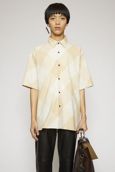Acne Studios cold beige/warm white shirt is crafted from lightweight cotton with a vichy check pattern and shaped to a boxy fit with short sleeves.