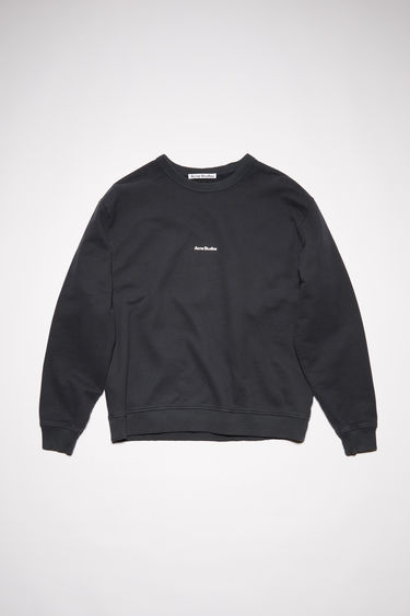 Acne Studios black crew neck sweatshirt is made of cotton with an Acne Studios logo at the centre chest.