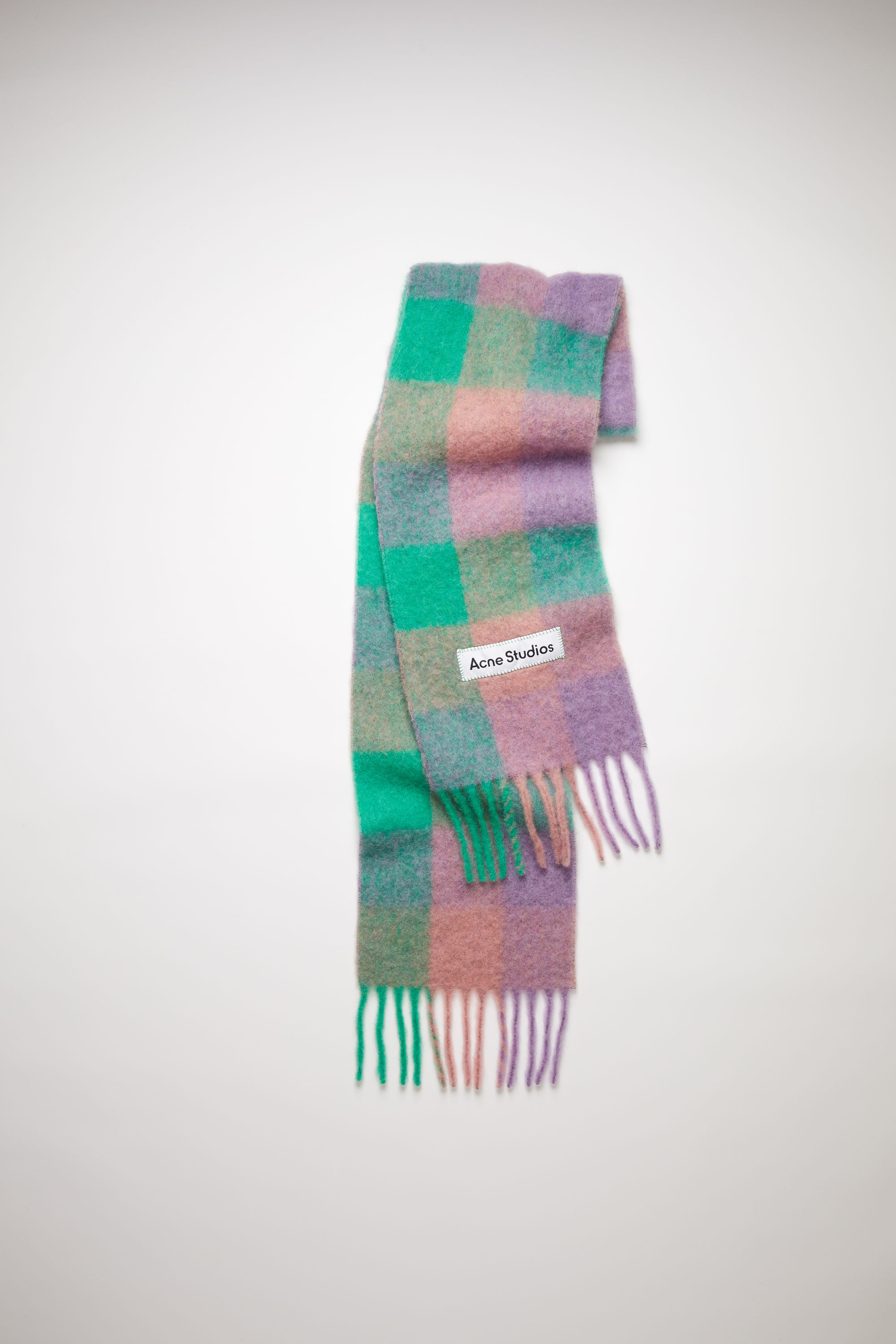Acne Studios lilac purple/green/pink large scale check scarf is made of an alpaca blend with fringed ends. 001