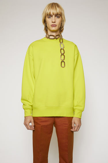 Acne Studios sharp yellow sweatshirt is cut to an oversized fit from heavyweight brushed jersey and finished with ribbed crew neck, cuffs and hem.