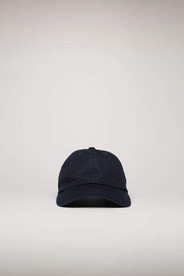 Acne Studios navy cap is crafted from cotton to a classic six-panel shape with a curved brim and accented with a tonal face-embroidered patch.