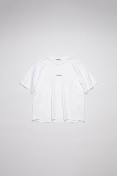 Acne Studios optic white t-shirt is made from pigment-dyed jersey that's lightly faded along the seams. It's cut to a relaxed silhouette with dropped shoulders and features a raised logo print on front.