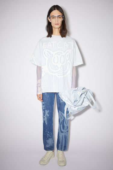 Acne Studios pale blue crew neck t-shirt is made of organic cotton with an all over bleached print.