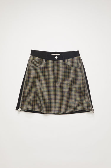 Acne Studios brown/black panel skirt is crafted from repurposed black rigid denim and checked wool featuring zip details and a leather waist band. Shaped to a straight short fit.