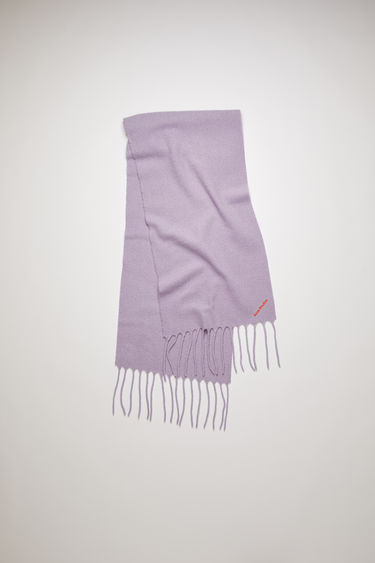 Acne Studios lavender purple scarf is crafted from soft boiled wool-blend and detailed with an embroidered Acne Studios logo.