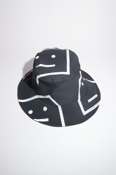 Acne Studios black bucket hat is made from structured twill with a large-scale face logo print.