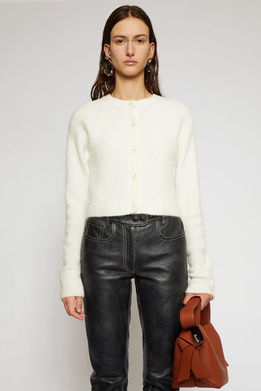 Acne Studios off white cardigan is crafted from an alpaca-wool blend to a boxy silhouette and neatly finished with ribbed edges around the neckline, cuffs and hem.