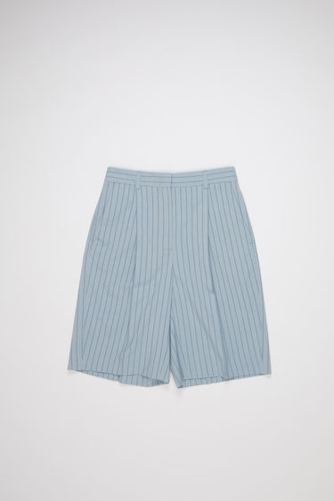 Acne Studios light blue/navy pinstriped knee-length shorts are made of a wool blend with a classic fit.