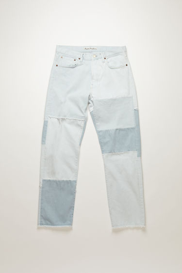 Acne Studios 1996 RF Light Blue jeans are handcrafted in a patchwork pattern from deadstock denim and finished with raw edges along the seams. They're cut to sit high on the waistband before falling into loose, straight legs.