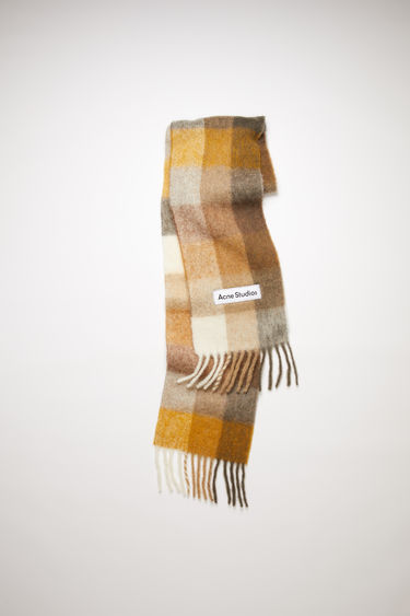 Acne Studios white/beige/brown large scale check scarf is made of an alpaca blend with fringed ends.