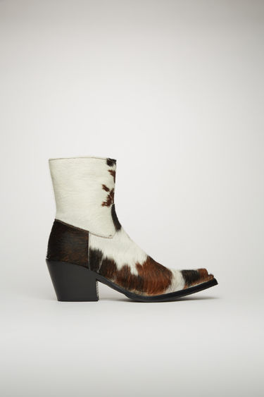 Acne Studios brown/white calf-hair boots are crafted to a Western-inflected silhouette and set on a stacked cuban heel.