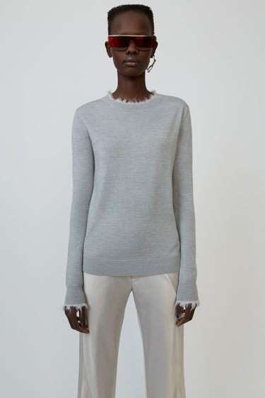 Acne Studios light grey melange sweater is crafted from wool and accented with fluffy trims around the neck and cuffs.