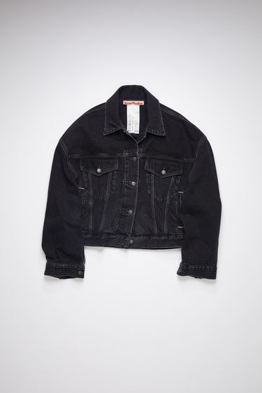 Acne Studios black cropped jacket is made of stone washed, black overdyed denim with an oversized fit.