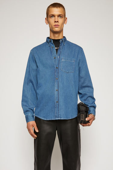 Acne Studios mid blue shirt is crafted from sateen denim to a slim silhouette and features contrasting topstitching at the edges.