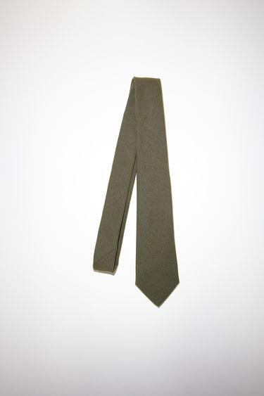 Acne Studios hunter green classic fit tie is made of a cotton/polyester blend.