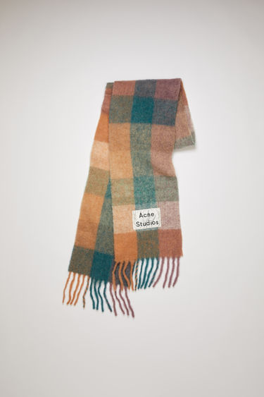 Acne Studios teal blue/lilac multi check scarf is spun with soft alpaca, wool and mohair and has an upscaled logo patch and fringed edges.