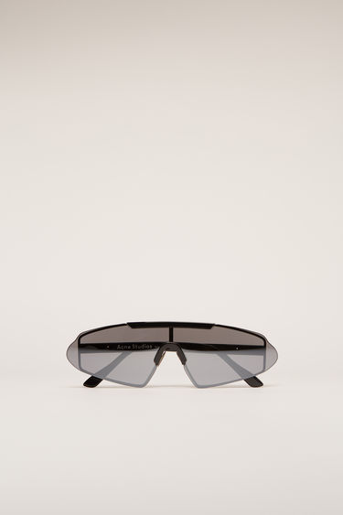 Acne Studios Bornt black black/silver sunglasses are crafted to an angular shape and then edged with stainless-steel metal frames with adjustable nose pads.