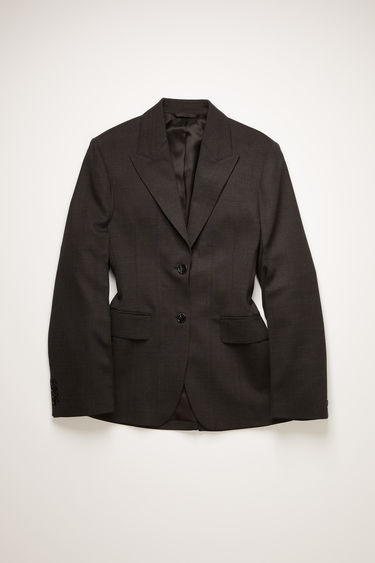 Acne Studios charcoal grey suit jacket is crafted from lightweight wool with peak lapels and is cinched in at the waist with darting to sculpt the silhouette.
