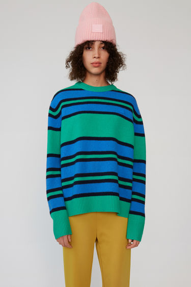 Acne Studios green multicolor stripe knit sweater with a contrasting face patch.
