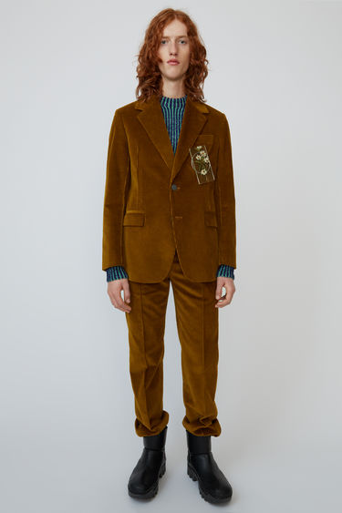 Acne Studios oil yellow suit jacket is cut from cotton-corduroy and shaped with wide lapels and padded shoulders.