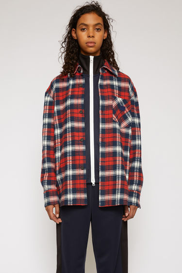 Acne Studios red/navy checked shirt is made from cotton flannel and features front patch pockets - forward with one and in reverse with the other - then accented with a face-embroidered patch.