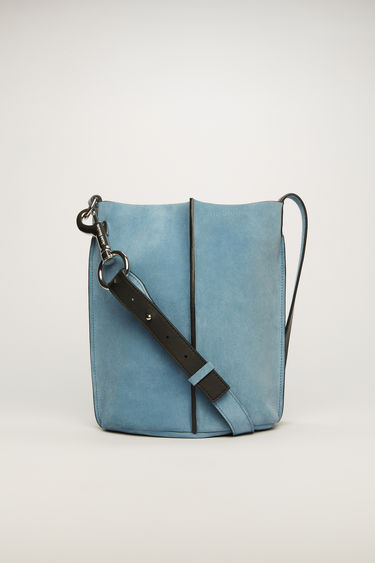 Acne Studios aqua blue bucket bag is crafted from suede with a logo-debossed leather lining and features an adjustable shoulder strap and a detachable zip wallet.