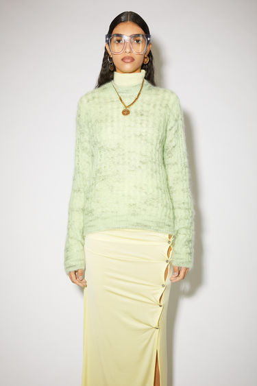 Acne Studios mint green crew neck sweater is made of a sheer, open knit mohair blend with a classic fit.