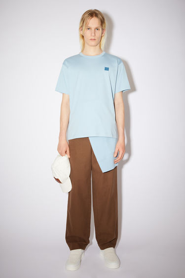 Acne Studios powder blue crew neck t-shirt is made from cotton with a regular fit and a face logo patch.