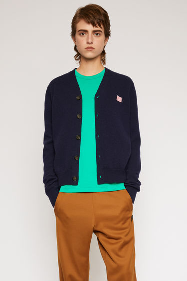 Acne Studios navy/pink cardigan is finely knitted from wool with a V-neckline and accented with a face-embroidered patch.