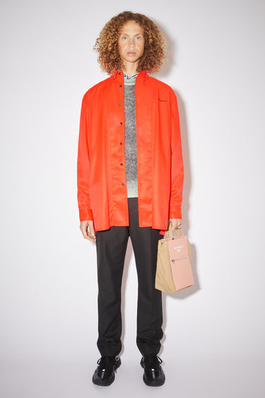 Acne Studios fluo red overshirt jacket has an Acne Studios logo embroidered at the chest and a mesh lining.