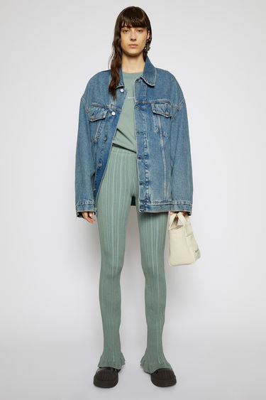 Acne Studios dusty green trousers are crafted from mercerised-cotton jersey and features an irregular ribbed pattern. They're shaped in a skinny-leg shape and finished with a frilled hem.